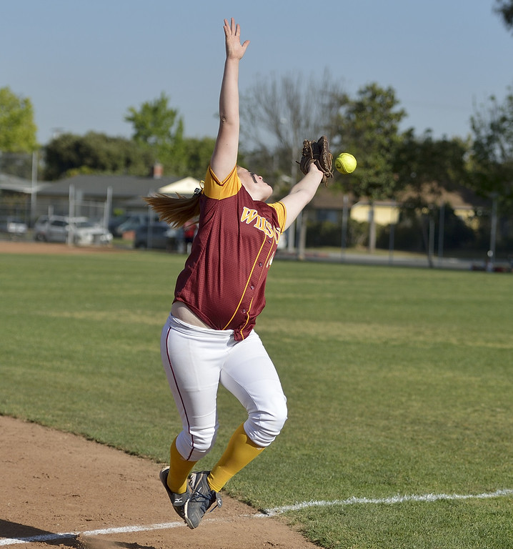 . LONG BEACH, CALIF. USA -- Wilson\'s Alexis Schiff (14) goes after a foul ball during their 11 to 1 loss to Lakewood in Lakewood, Calif., on May 2, 2013.  Photo by Jeff Gritchen / Los Angeles Newspaper Group