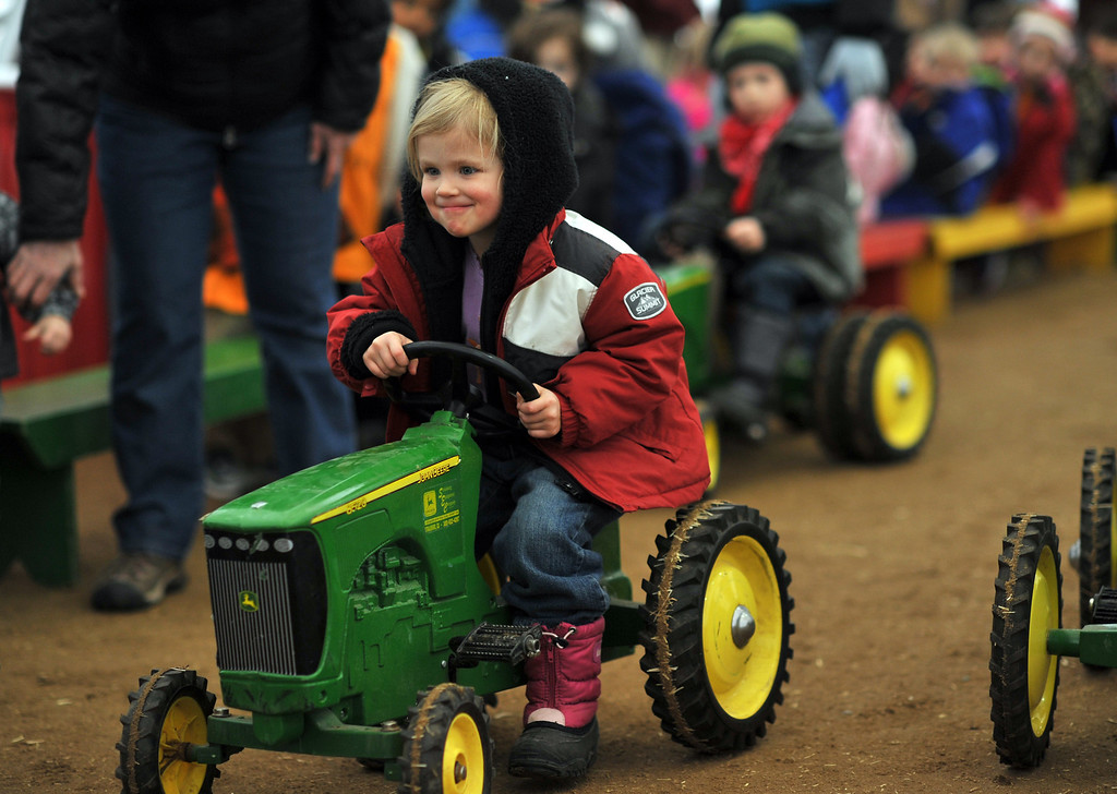 . Shiloh LeVos, 3, of Evergreen is pedaling during the tractor race at Ames Activity Pavilion of 2013 National Wester Stock Show on Tuesday. Denver. CO, January 15, 2013.  Hyoung Chang, The Denver Post
