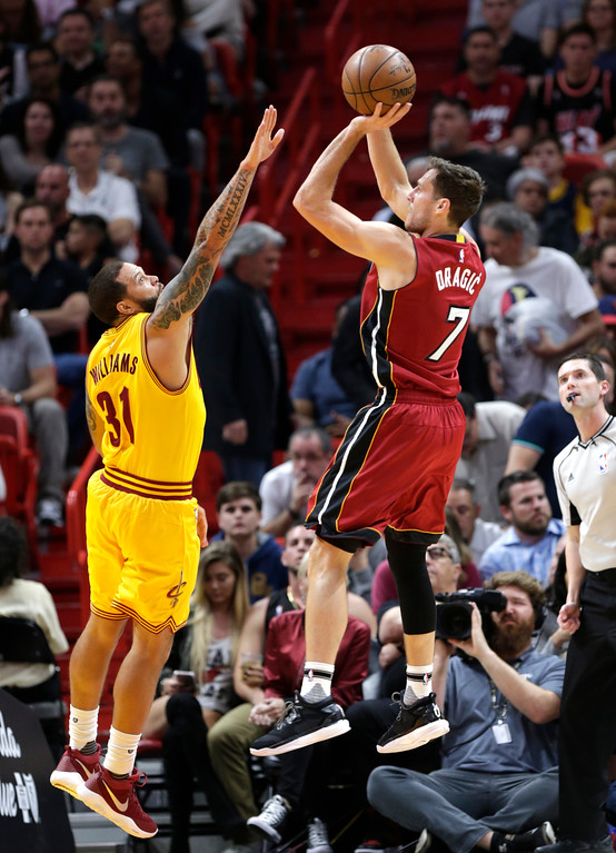 . Miami Heat\'s Goran Dragic (7) shoots as Cleveland Cavaliers\' Deron Williams (31) defends during the first half of an NBA basketball game, Saturday, March 4, 2017, in Miami. (AP Photo/Lynne Sladky)