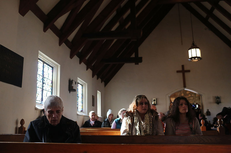 . People attend a prayer service to reflect on the violence at the Sandy Hook School at a church on December 15, 2012 in Newtown, Connecticut. Twenty six people were shot dead, including twenty children, after a gunman identified as Adam Lanza opened fire in the school. Lanza also reportedly had committed suicide at the scene. A 28th person, believed to be Nancy Lanza was found dead in a house in town, was also believed to have been shot by Adam Lanza.  (Photo by Spencer Platt/Getty Images)