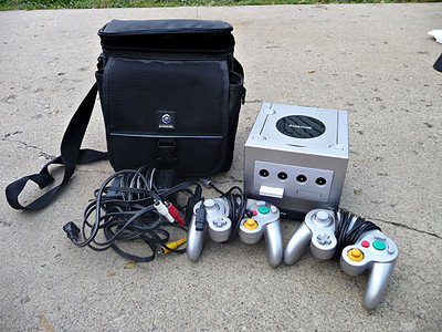 Nintendo Gamecube with 2 controllers, memory card, all cords, and carrying case.  Also includes Gameboy Player.  Excellent condition.  $80