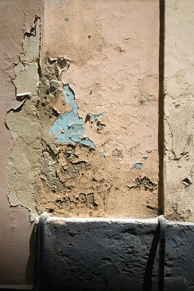 Texture of a colourful peeling off wall in the old town of Cadiz, Spain