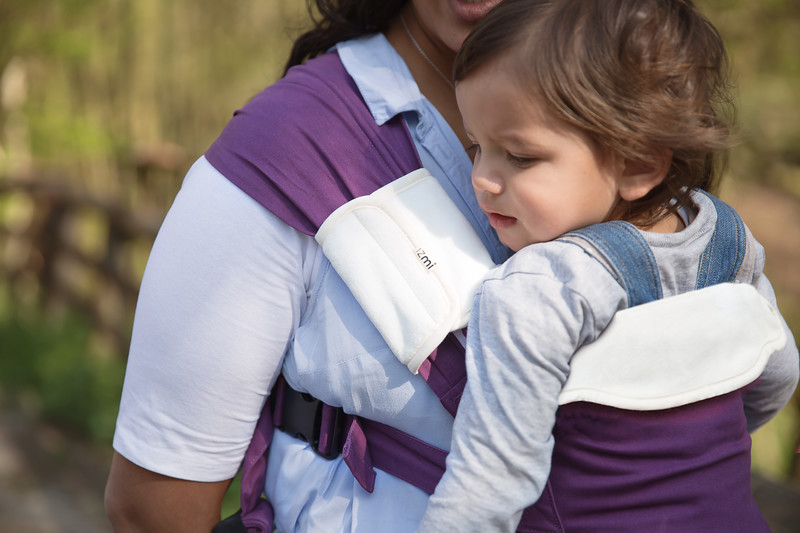 Izmi_Accessories_Lifestyle_Comfort_Bib_And_Shoulder_Straps_On_Purple_Baby_Carrier_Cropped.jpg