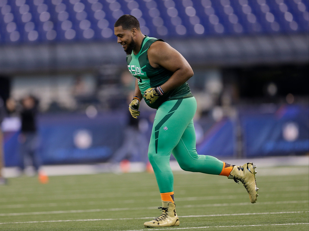 . Auburn defensive lineman Gabe Wright runs a drill at the NFL football scouting combine in Indianapolis, Sunday, Feb. 22, 2015. (AP Photo/David J. Phillip)