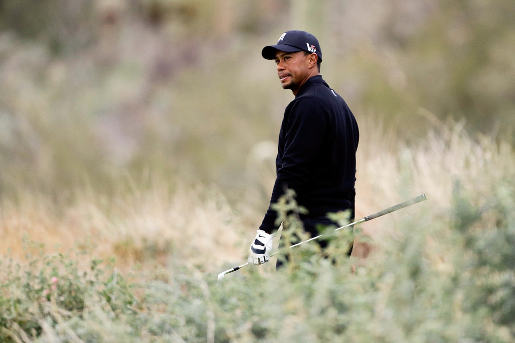 . Tiger Woods looks down from the 12th tee box at his lie on the fairway in the first round against Charles Howell III during the Match Play Championship golf tournament, Thursday, Feb. 21, 2013, in Marana, Ariz. (AP Photo/Ted S. Warren)
