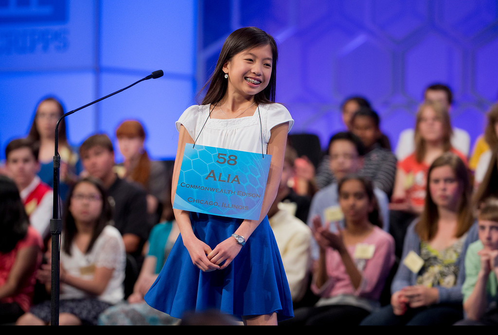 ". Alia Abiad, 14, of Western Springs, Ill., smiles after correctly spelling ""brindisi\"" during the finals of the Scripps National Spelling Bee, Thursday, May 29, 2014, at National Harbor in Oxon Hill, Md.  (AP Photo/Manuel Balce Ceneta)"