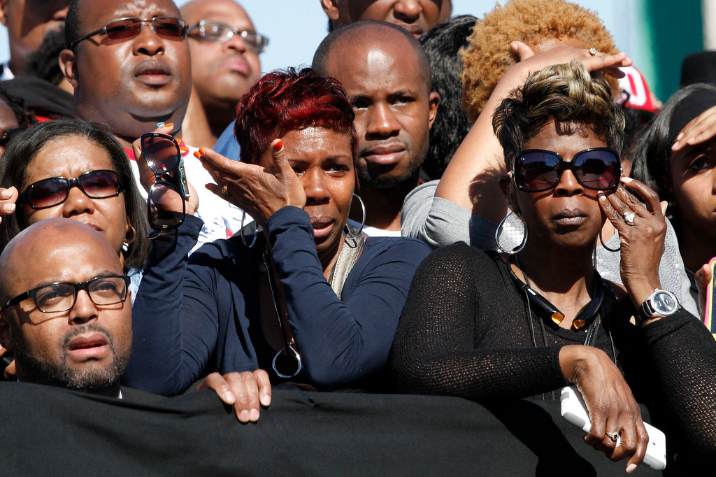 ". Lisa Logan, left, of Atlanta, and Evelyn Bias, of Selma, Ala., wipe away tears as they listen to Rep. John Lewis, D-Ga., speak about the beatings in Selma while introducing President Barack Obama to speak by the Edmund Pettus Bridge in Selma, Ala., for the 50th anniversary of ìBloody Sunday,"" a landmark event of the civil rights movement, Saturday, March 7, 2015. (AP Photo/Jacquelyn Martin)"