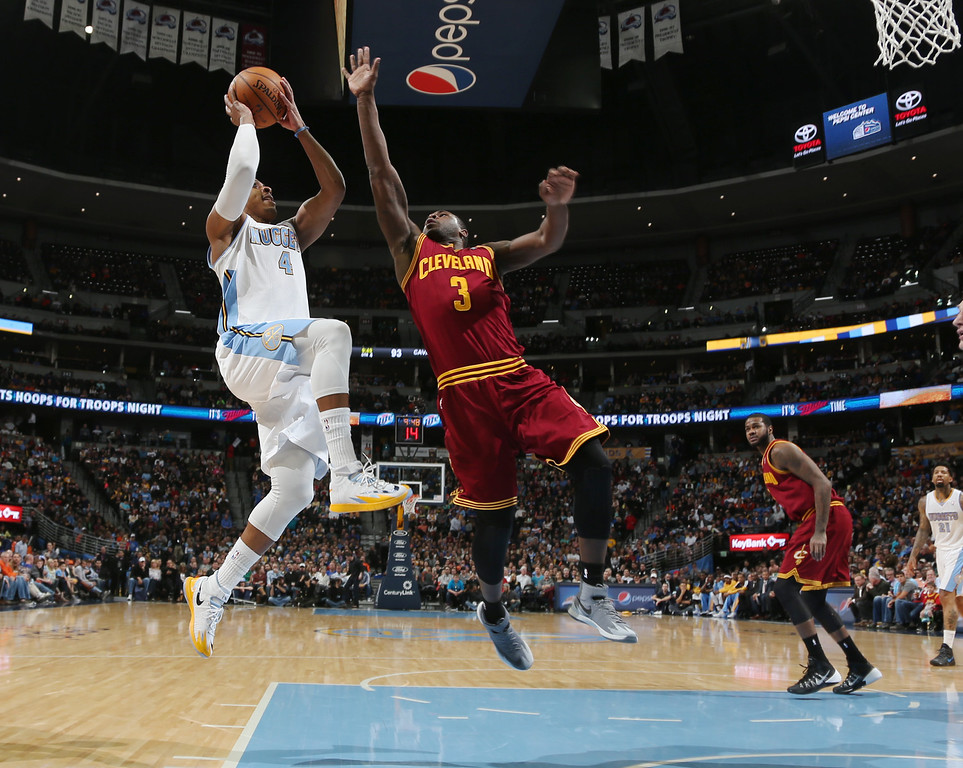 . Denver Nuggets guard Randy Foye, left, goes up for shot as Cleveland Cavaliers guard Dion Waiters covers in the fourth quarter of the Cavaliers\' 117-109 victory in an NBA basketball game in Denver on Friday, Jan. 17, 2014. (AP Photo/David Zalubowski)