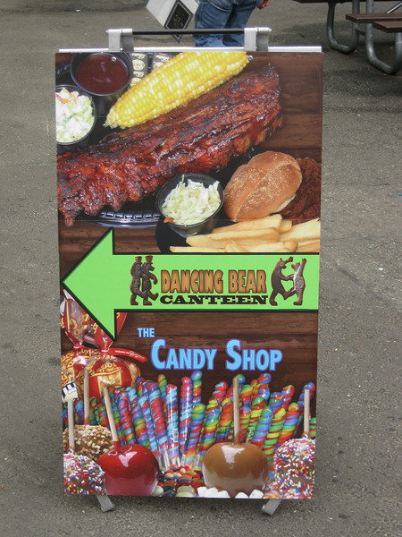 A new midway sign for Dancing Bear Canteen and the candy shop.