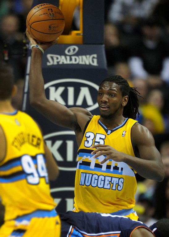 . Denver forward Kenneth Faried grabbed a rebound in the second half. The Denver Nuggets defeated the Charlotte Bobcats 110-88 at the Pepsi Center Saturday night, December 22, 2012.  Karl Gehring/The Denver Post