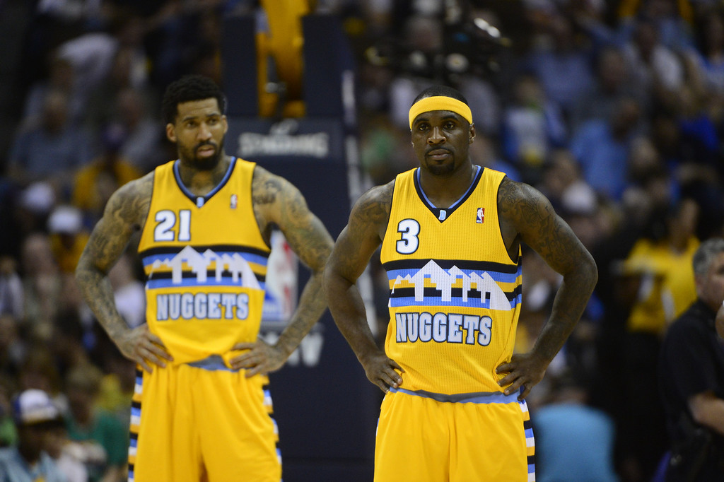 . DENVER, CO. - APRIL 20: Denver Nuggets point guard Ty Lawson (3) and Denver Nuggets shooting guard Wilson Chandler (21) wait for play to begin in the second quarter. The Denver Nuggets took on the Golden State Warriors in Game 1 of the Western Conference First Round Series at the Pepsi Center in Denver, Colo. on April 20, 2013. (Photo by AAron Ontiveroz/The Denver Post)