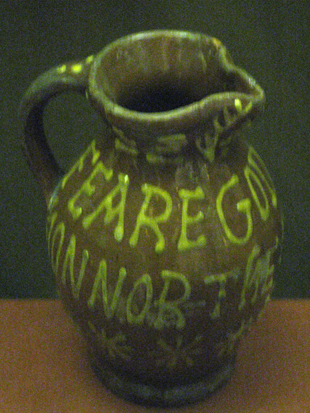 """My pottery research project was replicating pots like these, but I did it just from pictures.  It was satisfying to see the actual objects, which were quite a lot like mine.  This one says """"Feare God and Honnor the Kynge"""""""