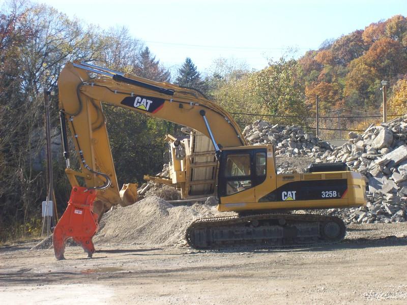 U31J concrete crusher on Cat excavator.JPG