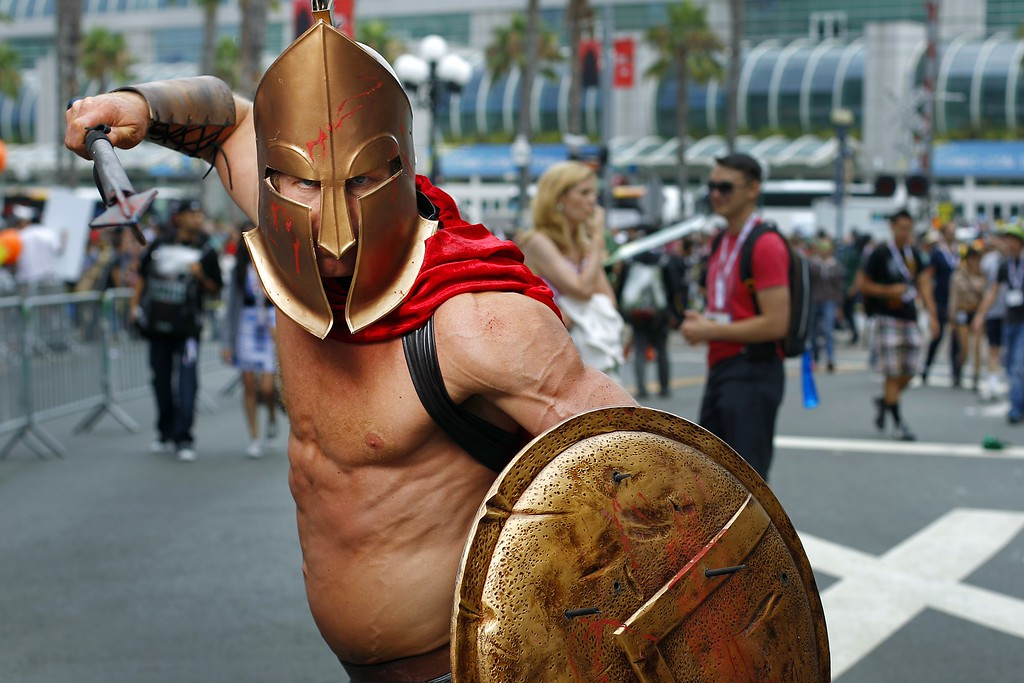 . Todd Schmidt, dressed as a Spartan, poses for a photo Friday, July 19, 2013, during Comic-Con in San Diego. (AP Photo/U-T San Diego, K.C. Alfred)