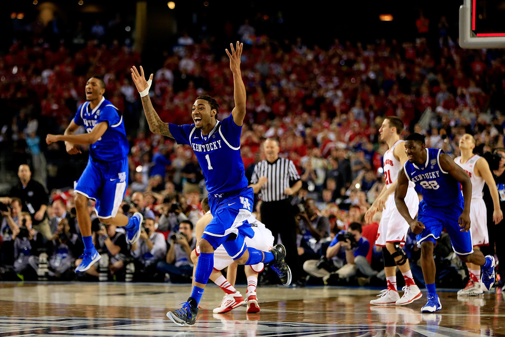 . ARLINGTON, TX - APRIL 05: James Young #1 of the Kentucky Wildcats reacts after defeating the Wisconsin Badgers 74-73 in the NCAA Men\'s Final Four Semifinal at AT&T Stadium on April 5, 2014 in Arlington, Texas.  (Photo by Jamie Squire/Getty Images)
