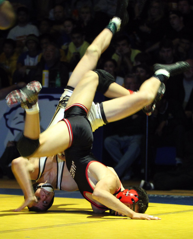 . James Logan\'s Artemio Flores, right, wrestles Windsor\'s Logan Fore in the 126-pound finals at the North Coast Section wrestling championships held at Newark Memorial High School in Newark, Calif., on Saturday, Feb. 23, 2013. Flores would get the win. (Anda Chu/Staff)
