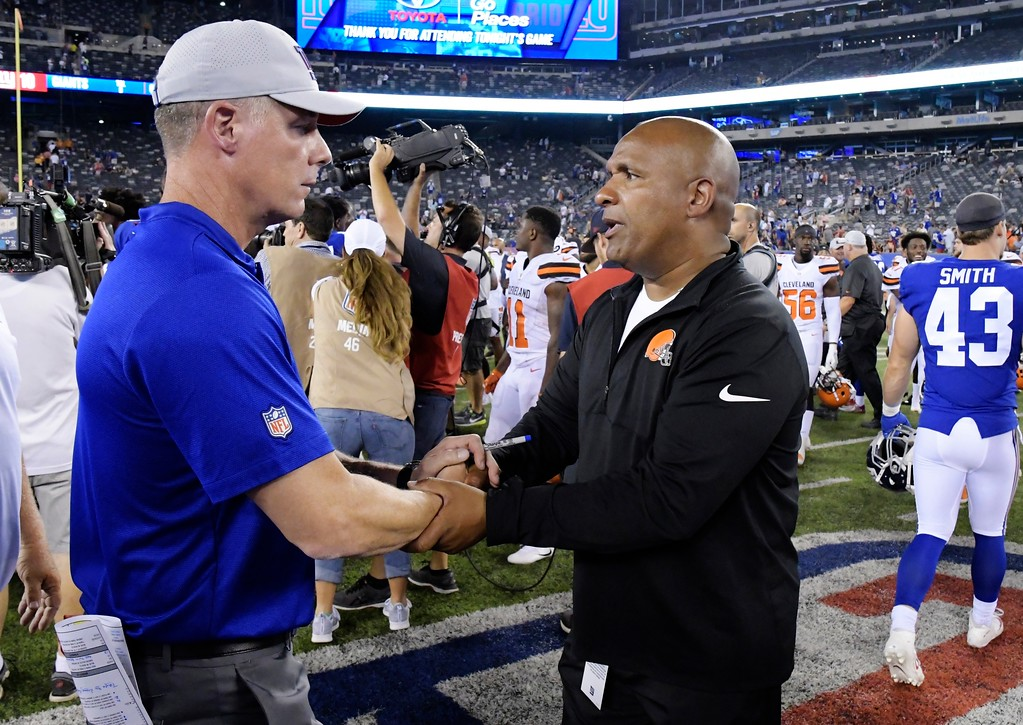 . New York Giants\' Pat Shurmur, left, and Cleveland Browns\' Hue Jackson shake hands after a preseason NFL football game Thursday, Aug. 9, 2018, in East Rutherford, N.J. (AP Photo/Bill Kostroun)