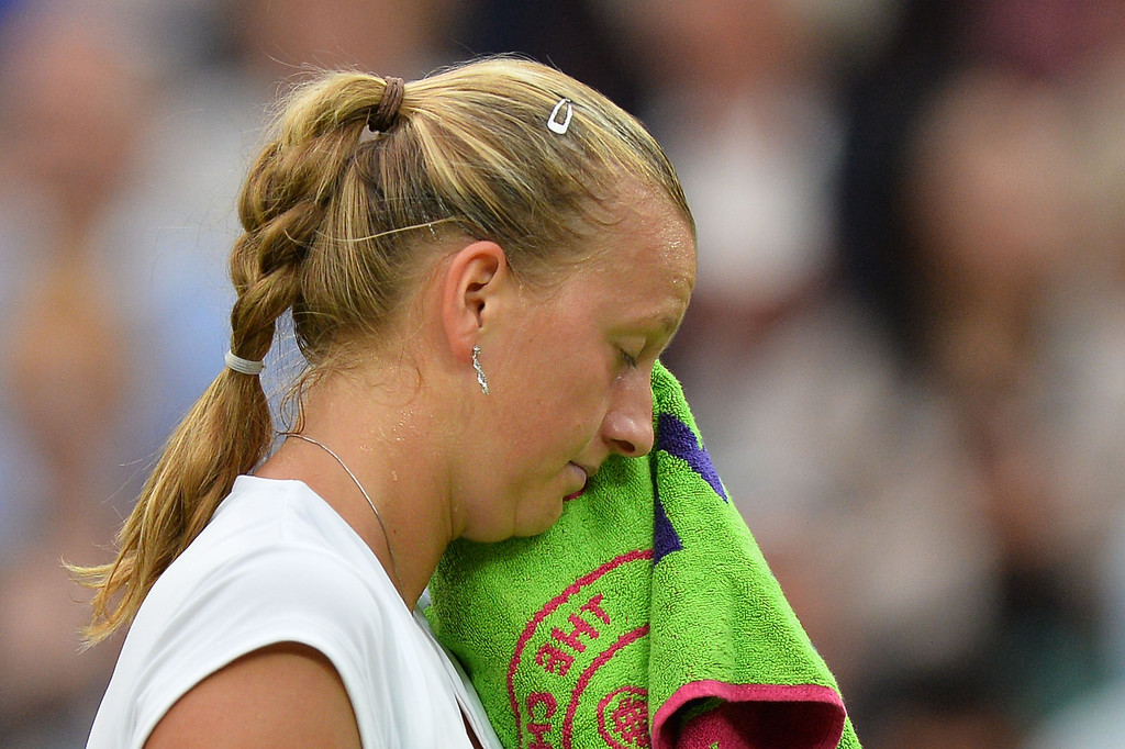 . Czech Republic\'s Petra Kvitova uses her towel between points against Belgium\'s Kirsten Flipkens during their women\'s singles quarter-final match on day eight of the 2013 Wimbledon Championships tennis tournament at the All England Club in Wimbledon, southwest London, on July 2, 2013. BEN STANSALL/AFP/Getty Images