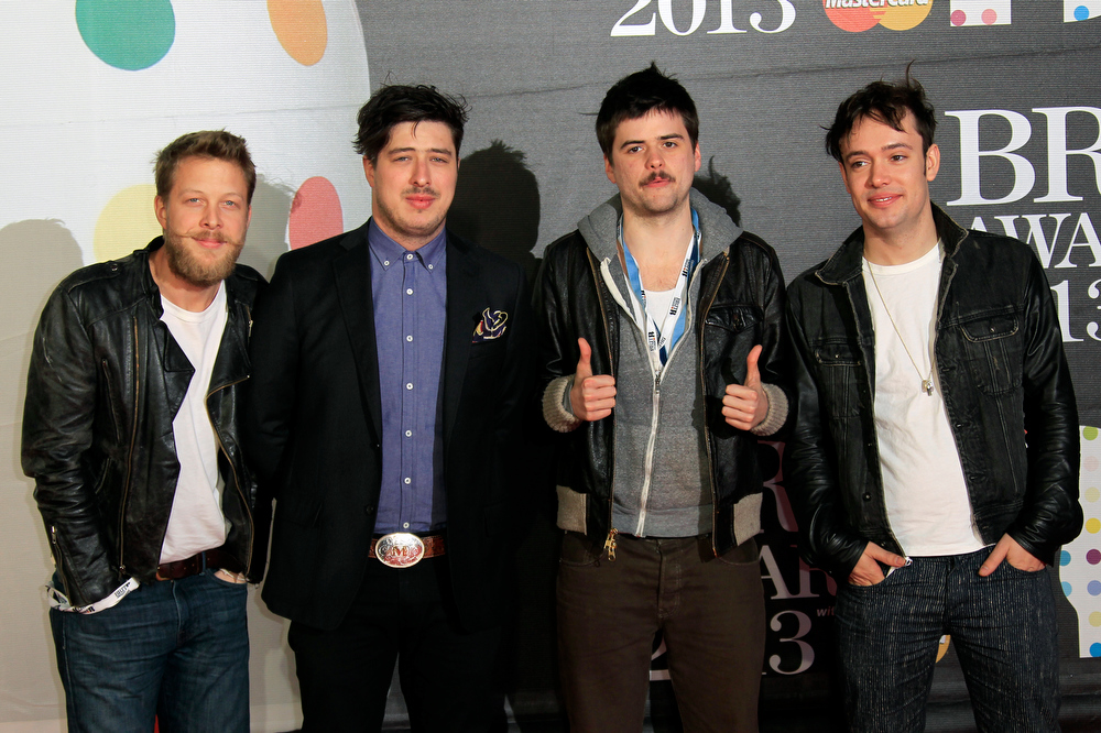 Description of . From left, Ted Dwane, Marcus Mumford, Country Winston, and Ben Lovett of British band Mumford and Sons seen arriving at the BRIT Awards 2013 at the o2 Arena in London on Wednesday, Feb. 20, 2013. (Photo by Joel Ryan/Invision/AP)