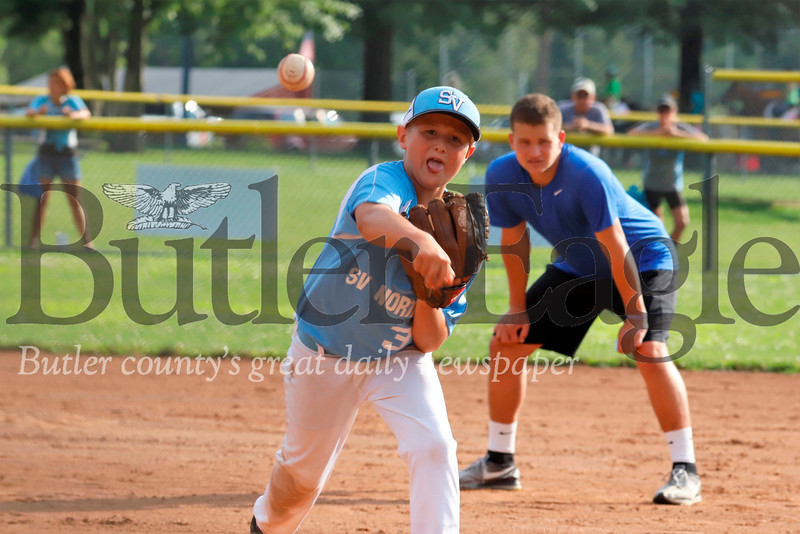 Seneca Valley Allstar 10U follows through on a pitch in tournament play against Shaler Thursday night at Zelienople Community Park. Seb Foltz/Butler Eagle