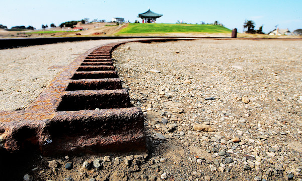 The Korean Bell is on a hill commanding view of LA Harbor and much of the coastline surrounding LA Harbor.  During WWII this hill was fortified with numerous shore batteries protecting the harbor.  This is a track that one of the cannons used to rotate its firing position.