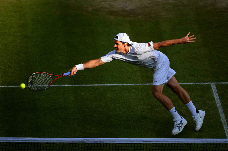 . Tommy Haas of Germany plays a forehand during the Gentlemen\'s Singles fourth round match against Novak Djokovic of Serbia on day seven of the Wimbledon Lawn Tennis Championships at the All England Lawn Tennis and Croquet Club on July 1, 2013 in London, England.  (Photo by Mike Hewitt/Getty Images)