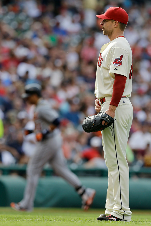 . Cleveland Indians starting pitcher Corey Kluber, right, waits for Detroit Tigers\' Victor Martinez, left, to run the bases after Martinez hit a two-run home run off Kluber in the third inning of a baseball game, Monday, Sept. 1, 2014, in Cleveland. Kluber pitched 2 2/3 innings and gave up seven hits and five runs. (AP Photo/Tony Dejak)