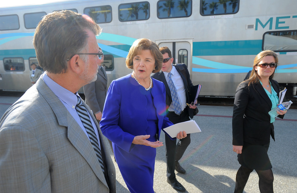 . Sen. Diane Feinstein talks with former Metrolink Chair Richard Katz as she arrives at a Metrolink event in which officials showed off their new Positive Transfer Control (PTC) in Los Angeles, CA on Thursday, February 20, 2014. The computer and satellite devices will be installed in all Metrolink trains and should prevent accidents. (Photo by Scott Varley, Daily Breeze)