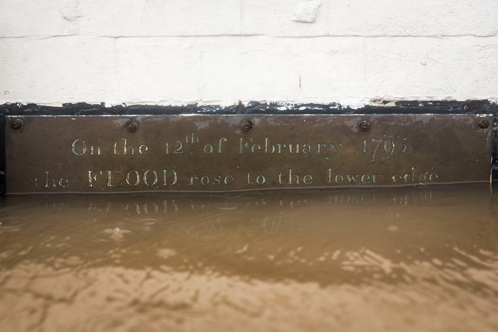 . A plaque on a wall of The Old Rectifying House reads \'On the 12th of February 1795 the FLOOD rose to the lower edge\' on February 12, 2014 in Worcester, England. The Environment Agency has issued flood warnings for dozens of areas along the River Severn. With heavier rains forecast for the coming week people are preparing for the water levels to rise. (Photo by Rob Stothard/Getty Images)