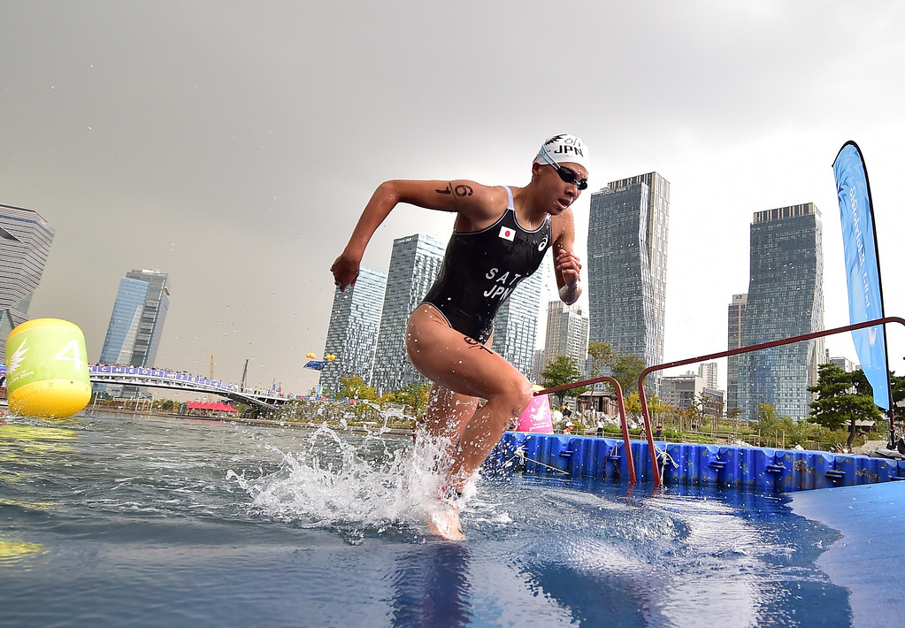 . Japan\'s Yuka Sato competes in the mixed triathlon final during the 2014 Asian Games at Songdo Central Park triathlon venue in Incheon on September 26, 2014. JUNG YEON-JE/AFP/Getty Images