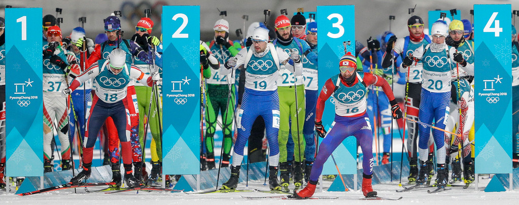 . Racers leave the start of the men\'s 12.5-kilometer biathlon pursuit at the 2018 Winter Olympics in Pyeongchang, South Korea, Monday, Feb. 12, 2018. (AP Photo/Gregorio Borgia)