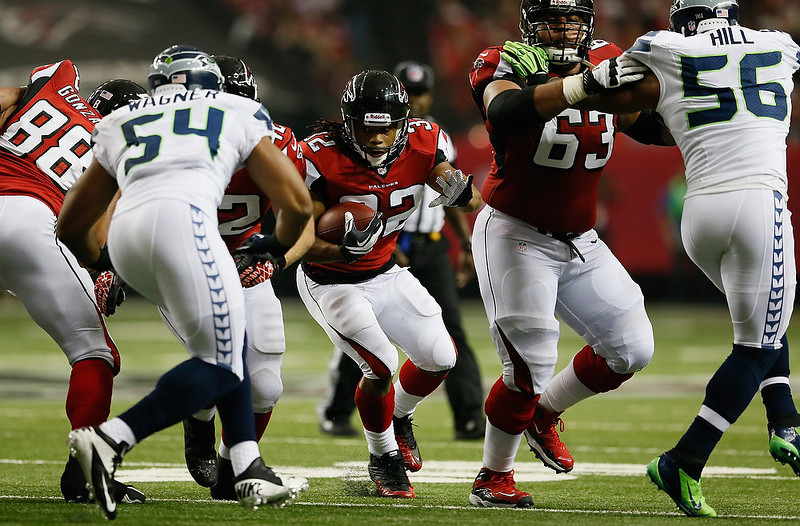 . Jacquizz Rodgers #32 of the Atlanta Falcons runs the ball against the Seattle Seahawks during the NFC Divisional Playoff Game at Georgia Dome on January 13, 2013 in Atlanta, Georgia.  (Photo by Kevin C. Cox/Getty Images)