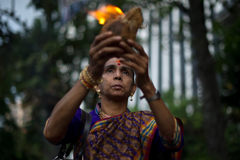 . A Malaysian Hindu prays to the deity Lord Ganesha during Diwali celebrations in the capital Kuala Lumpur on November 2, 2013. The Hindu festival of light, Diwali marks the homecoming of the God Lord Ram after vanquishing the demon king Ravana and symbolizes taking people from darkness to light and the victory of good over evil.  MOHD RASFAN/AFP/Getty Images
