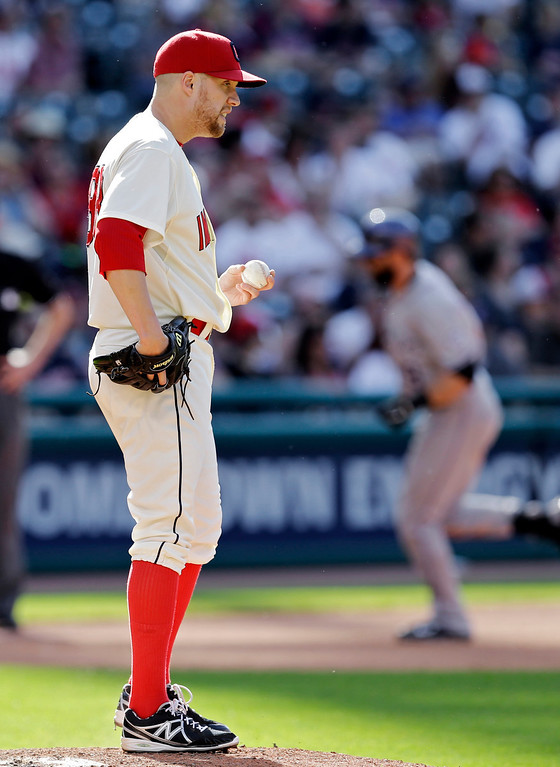 . Cleveland Indians relief pitcher Josh Outman looks away after giving up a three-run home run to Colorado Rockies\' Charlie Blackmon in the seventh inning of a baseball game Saturday, May 31, 2014, in Cleveland. (AP Photo/Mark Duncan)