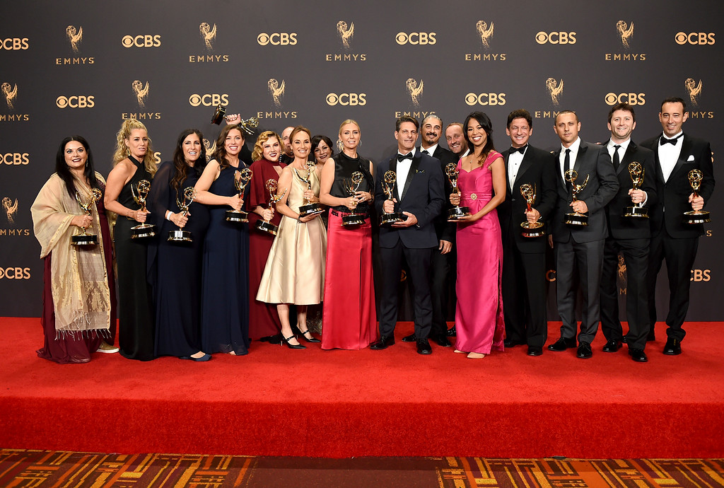 ". The cast and crew of ""The Voice\"" pose in the press room with their awards for outstanding reality-competition program at the 69th Primetime Emmy Awards on Sunday, Sept. 17, 2017, at the Microsoft Theater in Los Angeles. (Photo by Jordan Strauss/Invision/AP)"