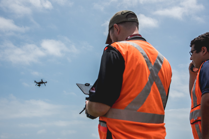 Steve Warr(left) pilots the quadcopter as Luis Hernandez works as a visual observer during the Lone Star UAS flight in Port Mansfield.