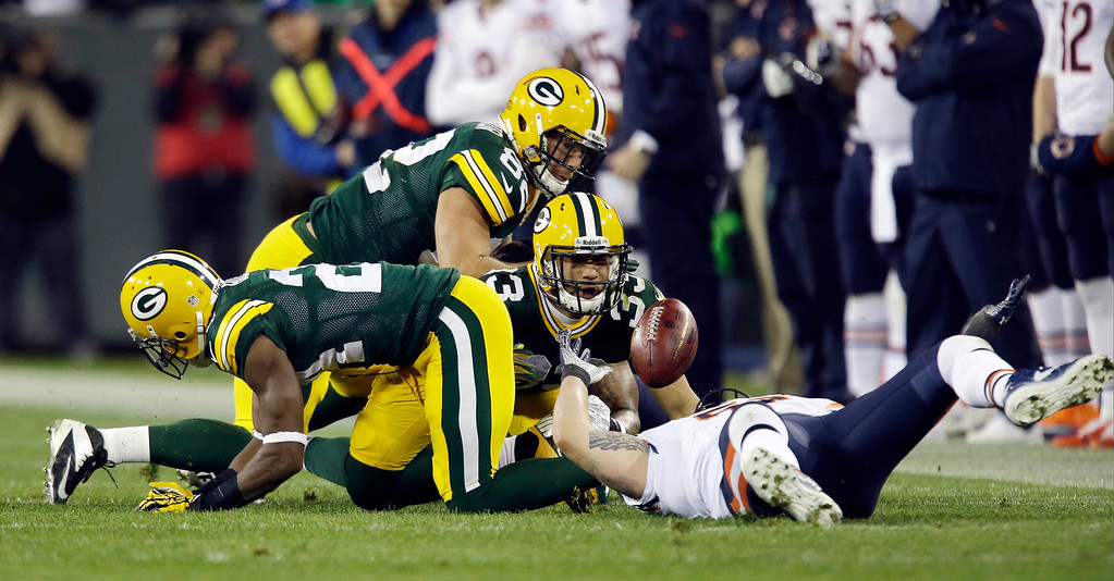 . Players scramble for a loose ball on an on side kick during the second half of an NFL football game between the Green Bay Packers and the Chicago Bears Monday, Nov. 4, 2013, in Green Bay, Wis. The Packers recovered the ball. (AP Photo/Jeffrey Phelps)