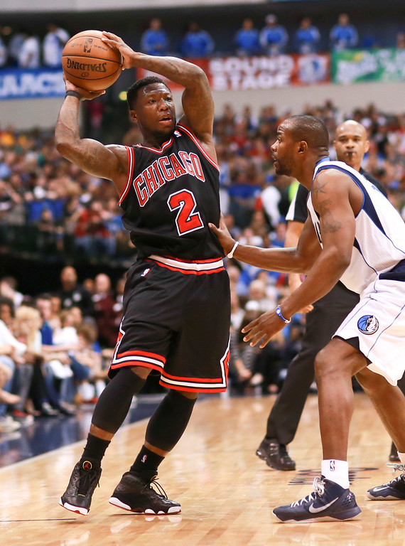 . Chicago Bulls point guard Nate Robinson (2) looks to pass during an NBA basketball game Saturday, March 30, 2013 in Dallas. Dallas defeated Chicago 100-98. (AP Photo/Michael Mulvey)