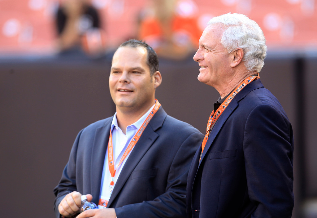 . Cleveland Browns owner Jimmy Haslam, right, talks with general manager Tom Heckert before the Browns play the Chicago Bears in a preseason NFL football game Thursday, Aug. 30, 2012, in Cleveland. (AP Photo/Tony Dejak)