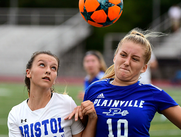 9/11/2018 Mike Orazzi | Staff Bristol Eastern's Sara Stadnicki (8) and Plainville's Isabella Niziolek (10) during Tuesday's soccer at Plainville High School.