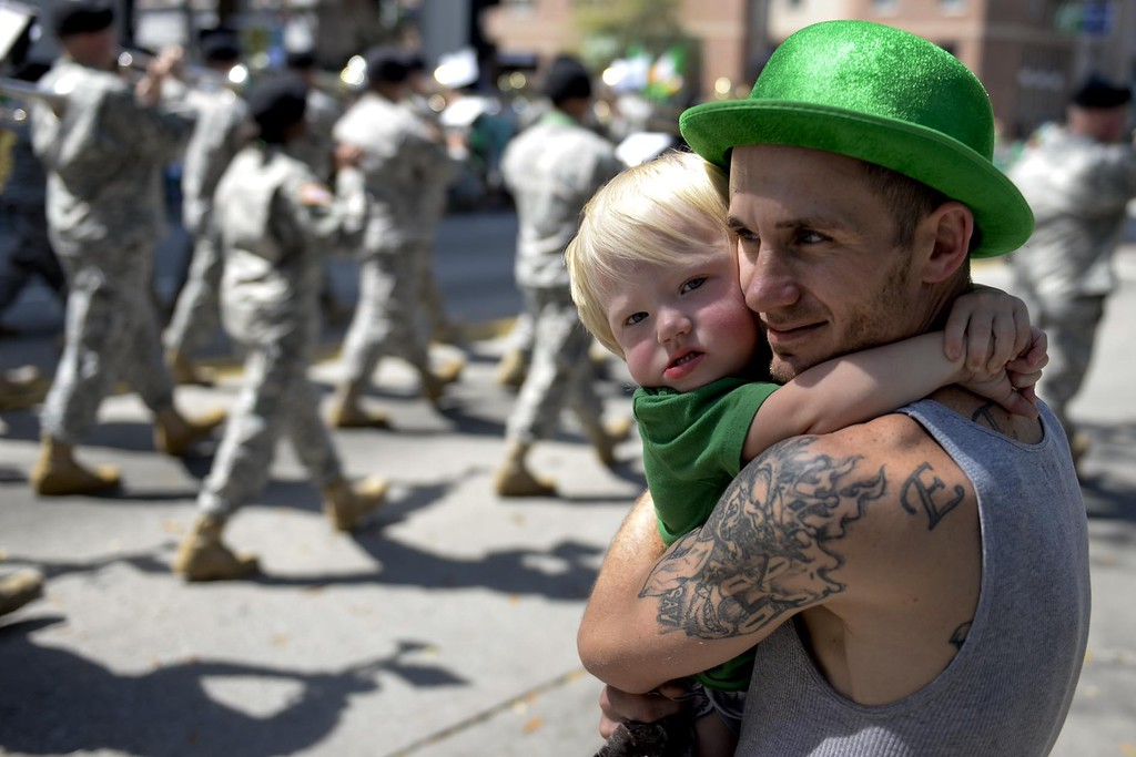 . Mike Tyson hold his son, Carson Virkett, 2, both of Savannah, while watching the St. Patrick\'s Day Parade in Savannah, Ga., Tuesday, March 17, 2015. (AP Photo/Savannah Morning News, Ian Maule) T