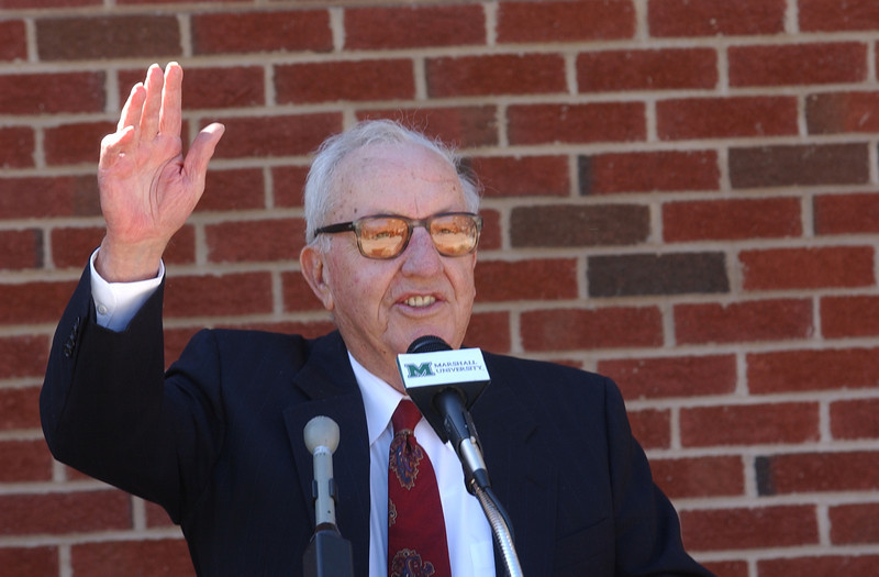 "Businessman and philanthropist James H. ""Buck"" Harless of Gilbert, W.Va., joined Marshall University's Board of Governors in dedicating the Harless Dining Hall on MU's Huntington campus March 10, 2004. Here he acknowledges the people present."