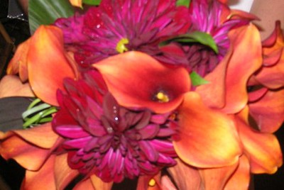 Dahlias, mango calla lilies, tropical greens  $135
