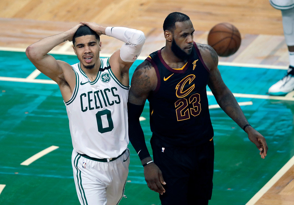 . Boston Celtics forward Jayson Tatum, left, reacts in front of Cleveland Cavaliers forward LeBron James during the second half in Game 7 of the NBA basketball Eastern Conference finals, Sunday, May 27, 2018, in Boston. (AP Photo/Charles Krupa)
