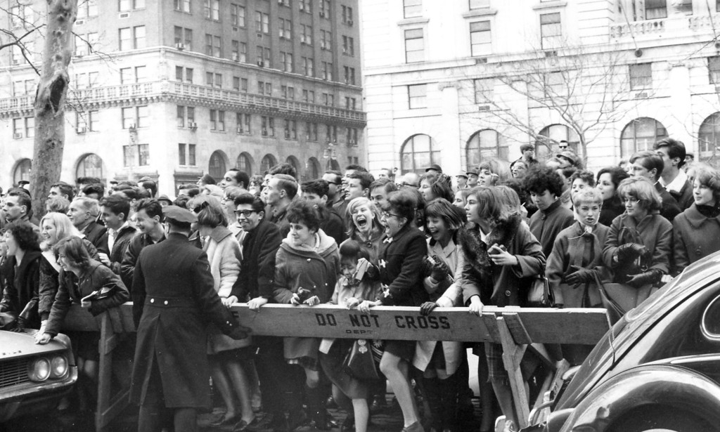 . Police enforce the barricades outside New York\'s Plaza Hotel as fans push forward in hopes of a view of The Beatles after their arrival for an American tour on February 7, 1964. (AP Photo)