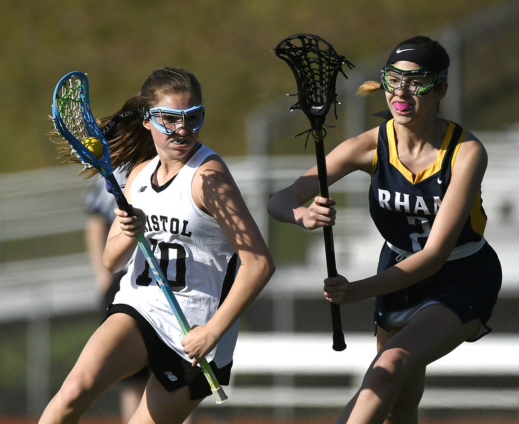 5/8/2018 Mike Orazzi   Staff Bristol Co-Op Lacrosse's Lily Hansen (10) and RHAM's Elisabeth Miano (2) during girls lacrosse at BEHS Tuesday.
