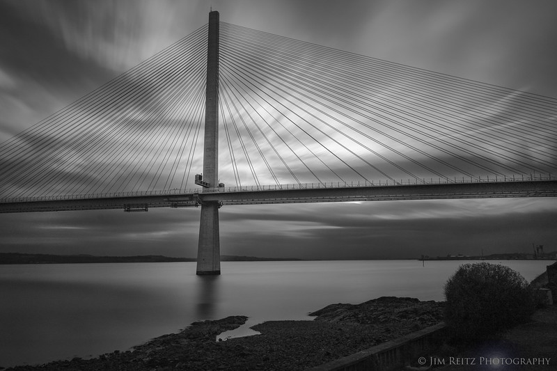 Long-exposure black & white image of Queensferry Crossing bridge near Edinburgh.