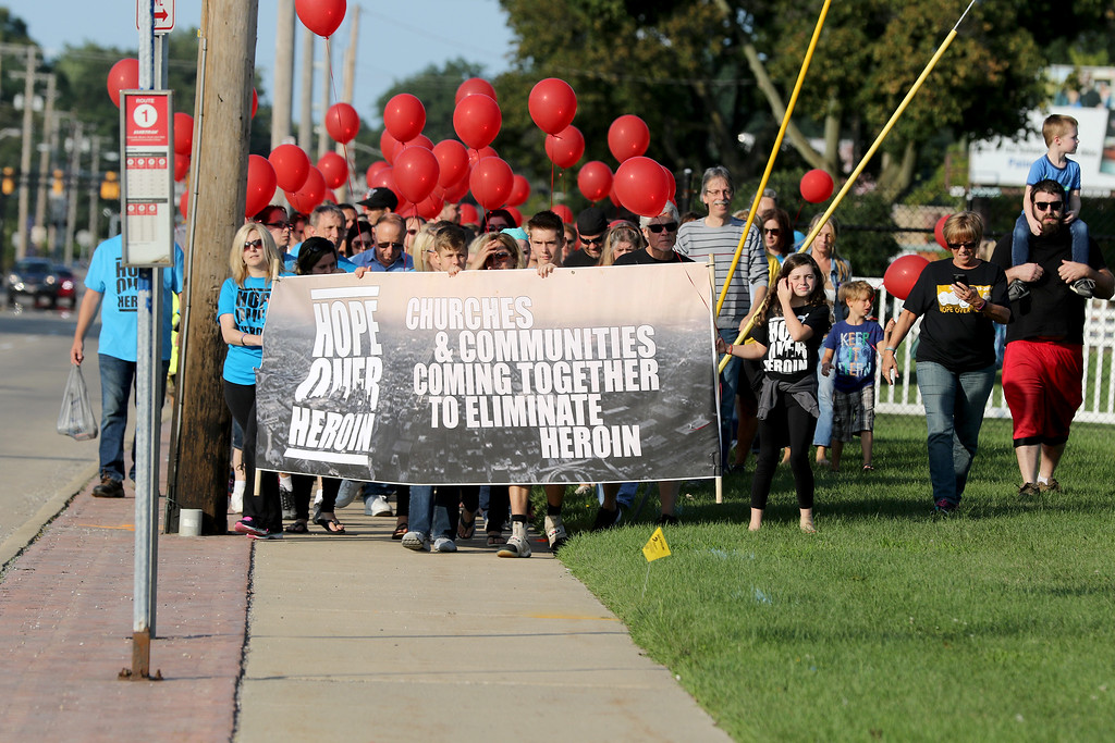 . Jonathan Tressler - The News-Herald. Hundreds of people, possibly a quarter-mile long, proceed west on Mentor Avenue during the prayer march/memorial at the start of the two-day Hope Over Heroin Lake County event Aug. 25.