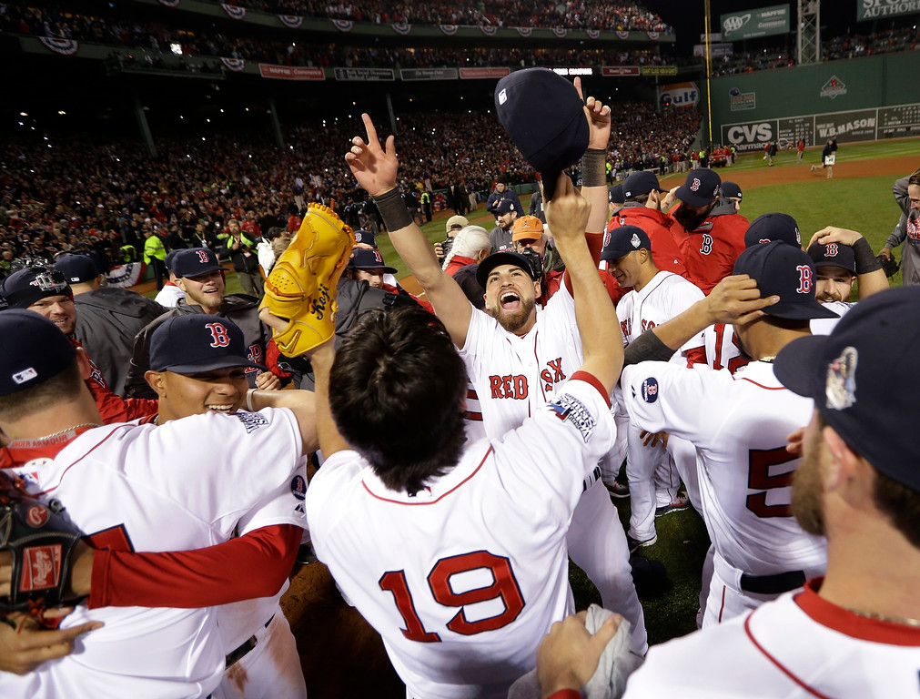 . The Boston Red Sox celebrate after defeating the St. Louis Cardinals in Game 6 of baseball\'s World Series Wednesday, Oct. 30, 2013, in Boston. The Red Sox won 6-1 to win the series. (AP Photo/David J. Phillip)