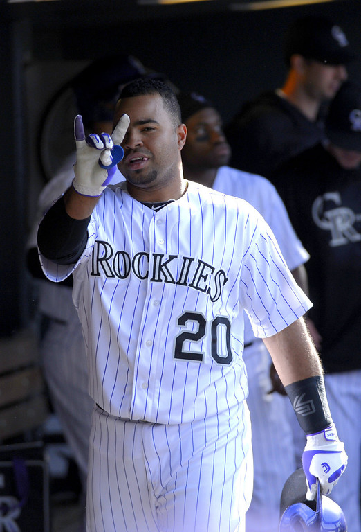. Colorado Rockies Wilin Rosario (20) gestures to the camera from the dugout after his three run home run in the seventh inning against the San Diego Padres April 7, 2013 at Coors Field. (Photo By John Leyba/The Denver Post)